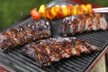Ribs-cooking-on-a-Bank-Holiday-BBQ-it-could-be-yours-1440x969
