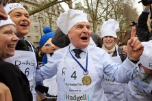 Stephen Pound celebrating victory, pictured at the 2016 Rehab Parliamentary Pancake Race, sponsored by Hudgell Solicitors, which saw teams of MPs, Lords and members of the media 'batter' it out in Victoria Tower Gardens, Westminster, on Shrove Tuesday, February 9 2016, in aid of the disability charity Rehab.  The event aims to raise awareness of the importance of supporting disabled people, with funds raised going towards Rehab's brain injury centres in Birmingham and Newcastle. Over in less than the time it takes to boil an egg, the race is a huge draw for tourists and international media alike, to see who will lift the Race's Magnificent Tin Cup. For more information, visit http://www.parliamentarypancakerace.co.uk
